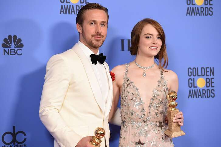 Actors Ryan Gosling and Emma Stone, winners of the Best Performance by an Actor/Actress in a Motion Picture ? Comedy or Musical for 'La La Land', pose in the press room at the 74th Annual Golden Globe Awards held at the Beverly Hilton Hotel on January 8, 2017. / AFP PHOTO / ROBYN BECKROBYN BECK/AFP/Getty Images