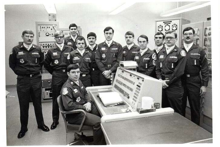 Allan Childers, second right, poses with others on a Titan II missile crew at Damascus, Ark. Childers was deputy commander of the crew in 1980, when an airman performing maintenance in the missile silo dropped a socket that pierced the rocket's fuel tank. The accident triggered an explosion that propelled a 9-megaton nuclear warhead into a ditch 200 yards away.
