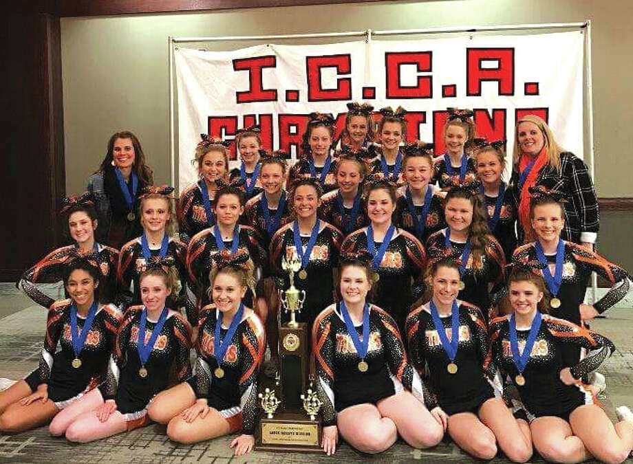 This past weekend, the EHS cheerleaders competed at the ICCA State Championships in Springfield, IL. The varsity team finished first out of ten teams in the large varsity division, defending their previous year's title. Junior Varsity placed third out of four teams in the large JV division. In addition to the Tigers' outstanding team placements, seniors Emma Moore, and Morgan Goebel were selected as two of the ten ICCA Scholarship finalists based on their academic and cheerleading credentials as well as an interview. Moore earned a $500 scholarship and Goebel received the top scholarship of $4,000. Photos for the Intelligencer. Photo: For The Intelligencer