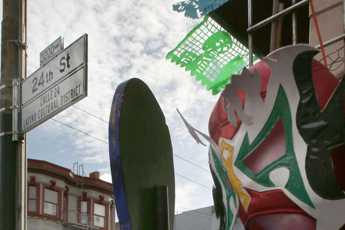 View of 24th street sign next to the Mixcoatl Arts and Crafts store on Monday, January 9, 2017, in San Francisco, Calif.
