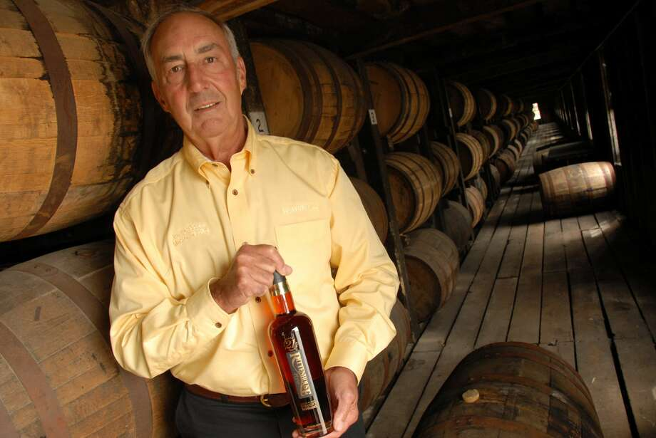 FILE - Heaven Hill's Master Distiller Parker Beam holds a bottle of Rittenhouse Rye Whisky made there at the Bardstown, Ky. distillery Sept. 20, 2006. Photo: PATTI LONGMIRE/AP