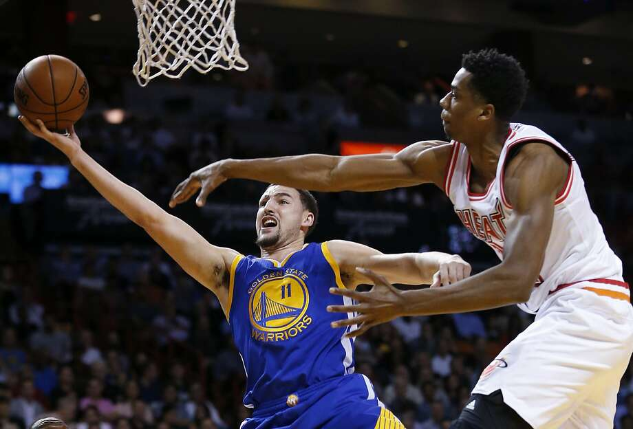 Golden State Warriors guard Klay Thompson (11) attempts a shot against Miami Heat center Hassan Whiteside during the first half of an NBA basketball game Wednesday, Feb. 24, 2016, in Miami. (AP Photo/Wilfredo Lee) Photo: Wilfredo Lee, Associated Press
