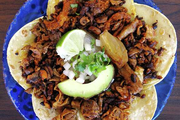 """Mini-tacos """"A La Yaka"""" with carnitas, tripas, pastor and carne asada from Taqueria Datapoint on Medical Drive."""