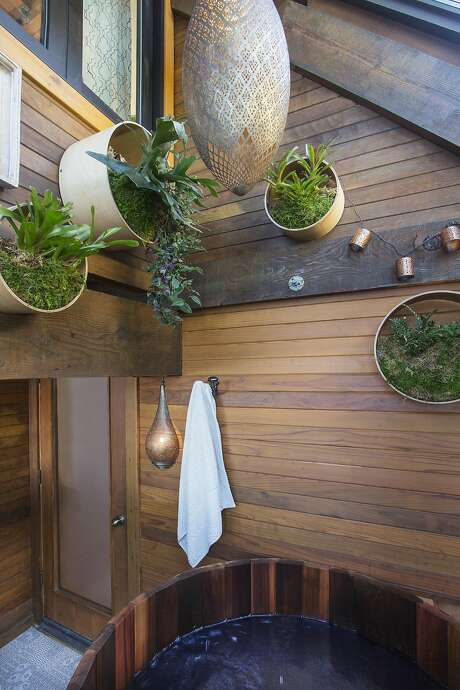 Plants enliven the hot tub area aboard the houseboat. Photo: Margot Hartford