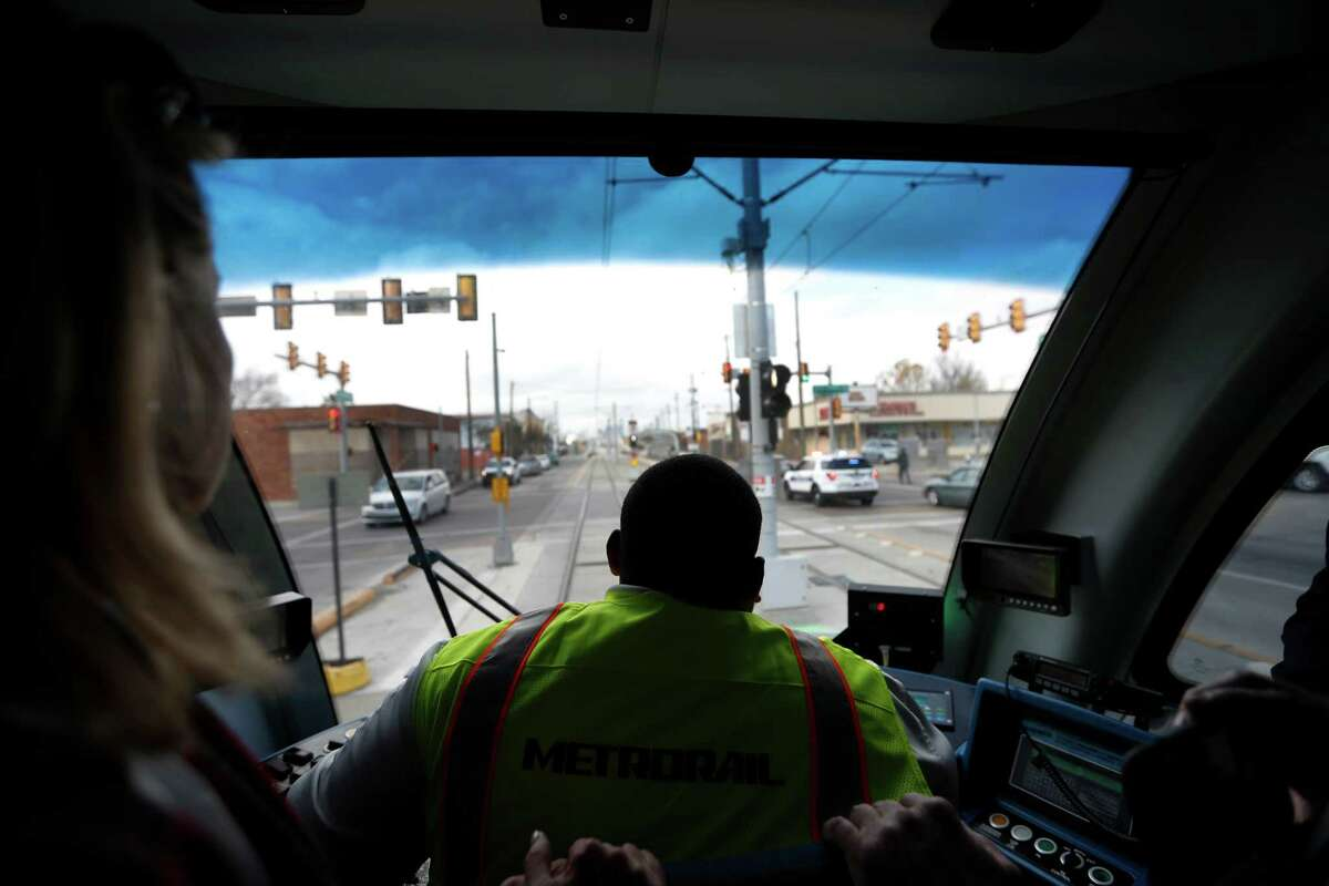 Charles Alexander, a Metro light rail operator, guides the inaugural Green Line train across the recently completed Harrisburg overpass on Jan. 9. The ride marks the official completion of the Metro's Green Line which bridges communities and connects the line to the Magnolia Park Transit Center.