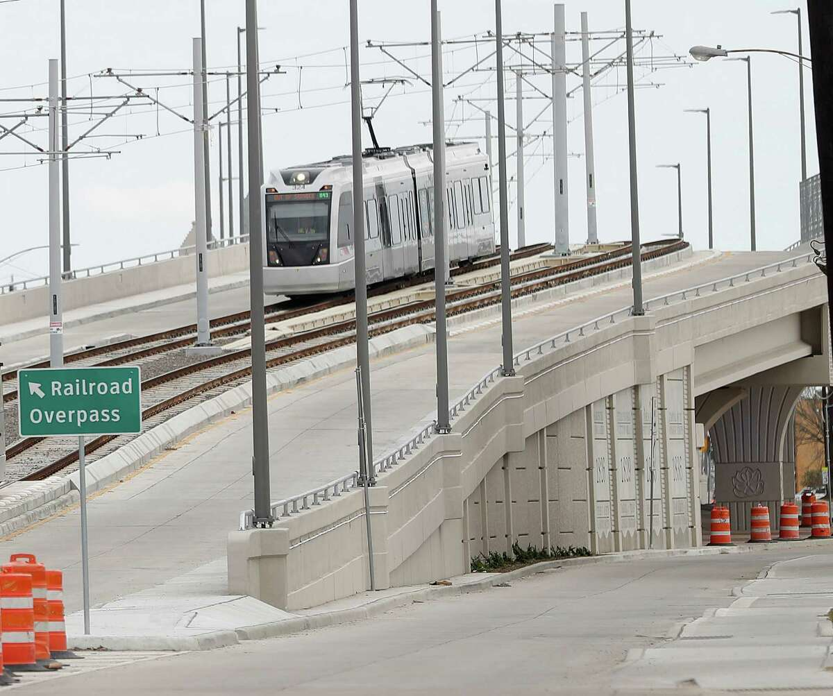 A Metro train crosses the recently-completed Harrisburg overpass on Jan. 9. The overpass was the final piece of Metro's $2.2 billion rail expansion, started in 2009.