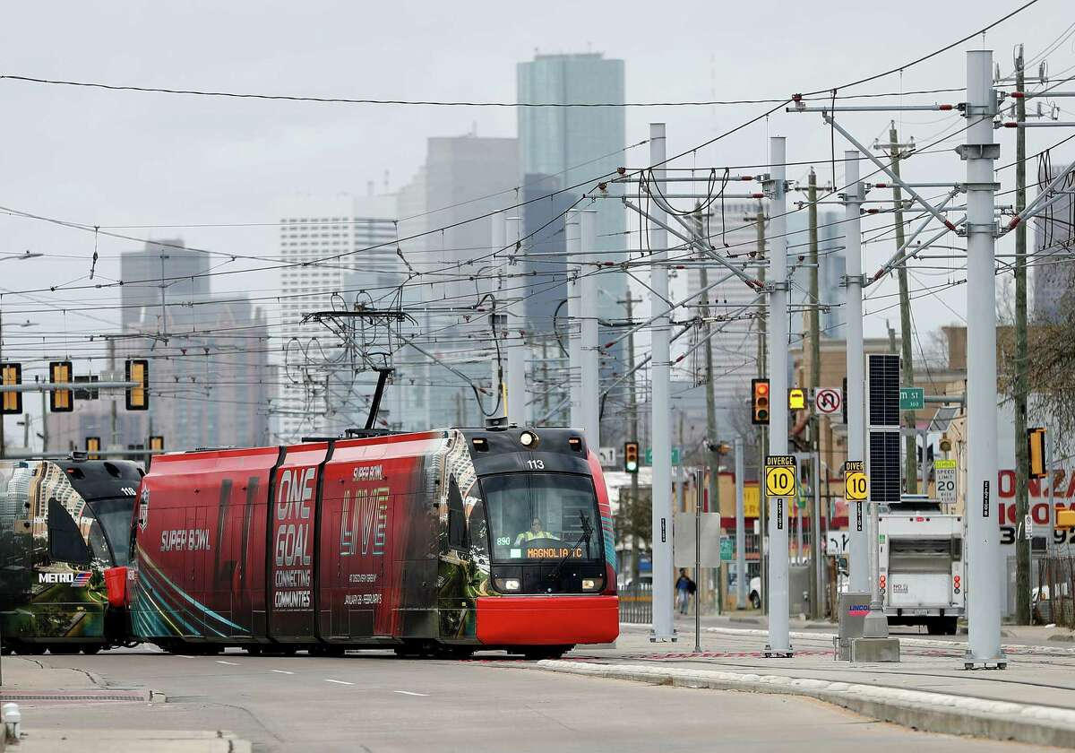 A METRORail train cuts across Harrisburg as it made it's way across the recently completed Harrisburg Overpass Bridge, with downtown Houston in the background, Monday, January 9, 2017. The ride marks the official completion of the METRORail's Green Line which bridges communities and connects the line to the Magnolia Park Transit Center. ( Karen Warren / Houston Chronicle )