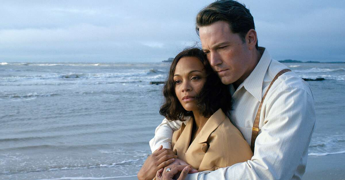 """This image released by Warner Bros. Entertainment shows Zoe Saldana, left, and Ben Affleck in a scene from """"Live By Night."""" (Claire Folger/Warner Bros. Entertainment via AP)"""