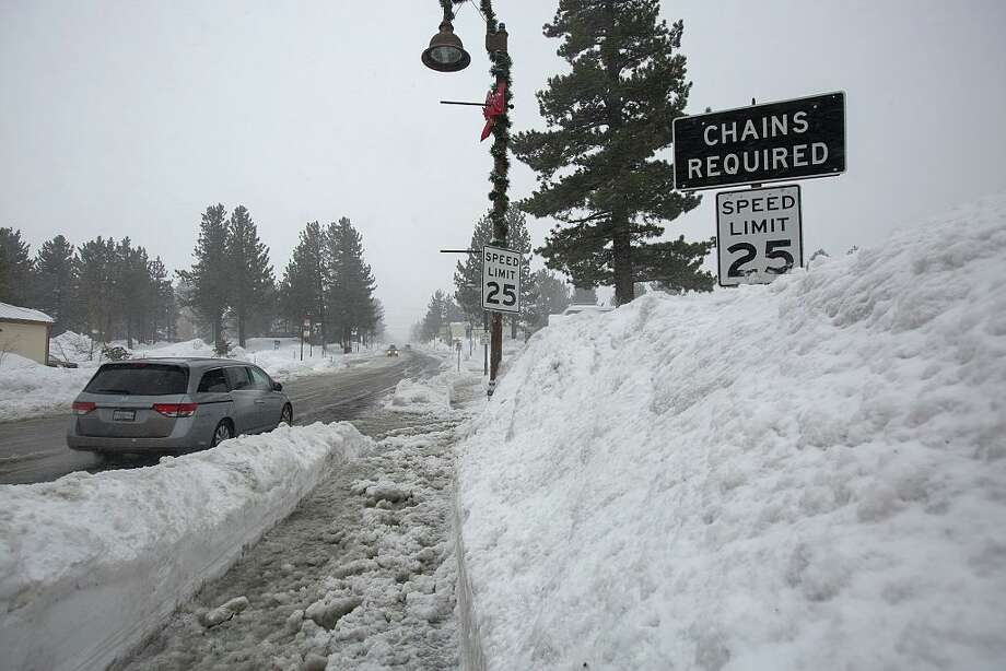 Snow piles continue to grow in Mammoth Lakes, California, January 9, 2017 as a series of strong storms moves through the western US state.  Photo: DAVID MCNEW/AFP/Getty Images