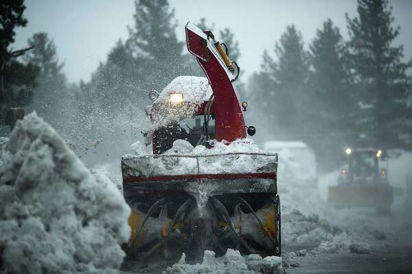 Snow removal crews work to keep up with falling snow in Mammoth Lakes, California, January 9, 2017 as a series of strong storms moves through the western US state.
