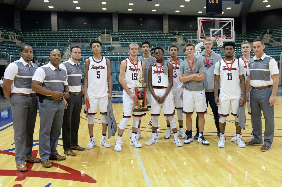 The Tompkins Falcons boys team poses after a second place finish in the Gold Bracket of the Katy ISD-Phillips 66 Tournament at the Leonard Merrell Center, Katy, TX on Saturday December 3, 2016.