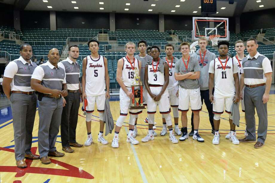 The Tompkins Falcons boys team poses after a second place finish in the Gold Bracket of the Katy ISD-Phillips 66 Tournament at the Leonard Merrell Center, Katy, TX on Saturday December 3, 2016. Photo: Craig Moseley, Houston Chronicle / ©2016 Houston Chronicle