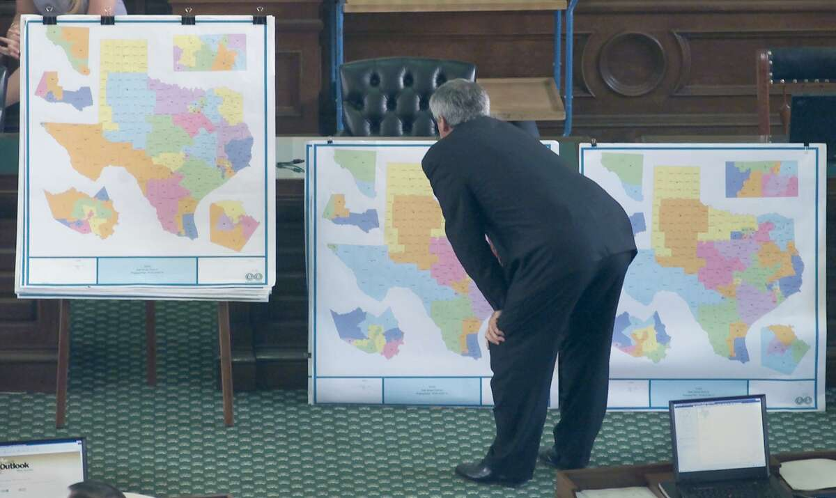 Texas' redistricting has always been ripe for legitimate challenge for a long time. Here, Sen. Eliot Shapliegh, D-El Paso, takes a closer look at different versions of proposed redistricting plans on display on the floor of the Texas Senate in 2001.