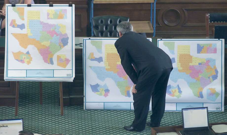 Texas' redistricting has always been ripe for legitimate challenge for a long time. Here, Sen. Eliot Shapliegh, D-El Paso, takes a closer look at different versions of proposed redistricting plans on display on the floor of the Texas Senate in 2001. Photo: HARRY CABLUCK /AP / AP