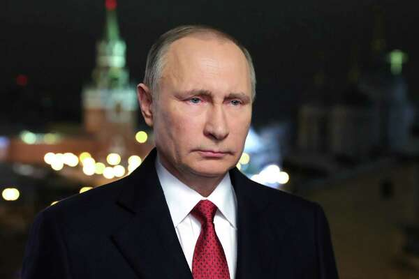 Russian President Vladimir Putin makes his New Year's address to the nation in Moscow's Kremlin, Dec. 31. Donald Trump's refusal to believe the leader ordered interference in U.S. elections is puzzling.