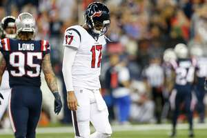 Houston Texans quarterback Brock Osweiler (17) walks off the field after not converting on fourth down against the New England Patriots during the fourth quarter of an NFL football game at Gillette Stadium on Thursday, Sept. 22, 2016, in Foxborough, Mass. ( Brett Coomer / Houston Chronicle )