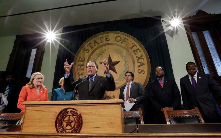 Sen. Jose Rodriguez, D-El Paso, center, stands with Texas legislators and civil rights representatives at a news conference in the Capitol on Monday. Rodriguez called on Gov. Greg Abbott and legislators to protect the rights of minorities and immigrants.