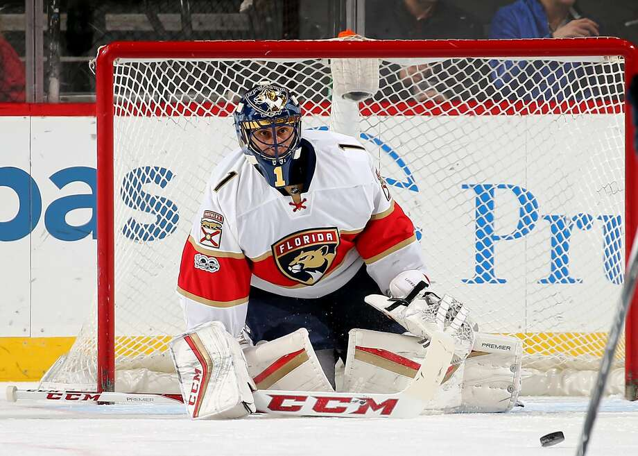 Florida's Roberto Luongo stops a first-period shot against New Jersey, one of his 28 saves in his 73rd career shutout. Photo: Elsa, Getty Images