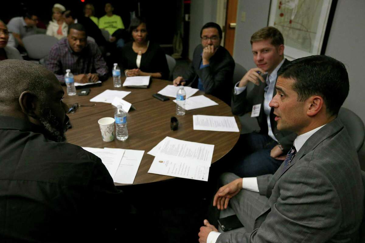 Bexar County District Attorney Nico LaHood (right) talks with others at the fifth police-community relations meeting.