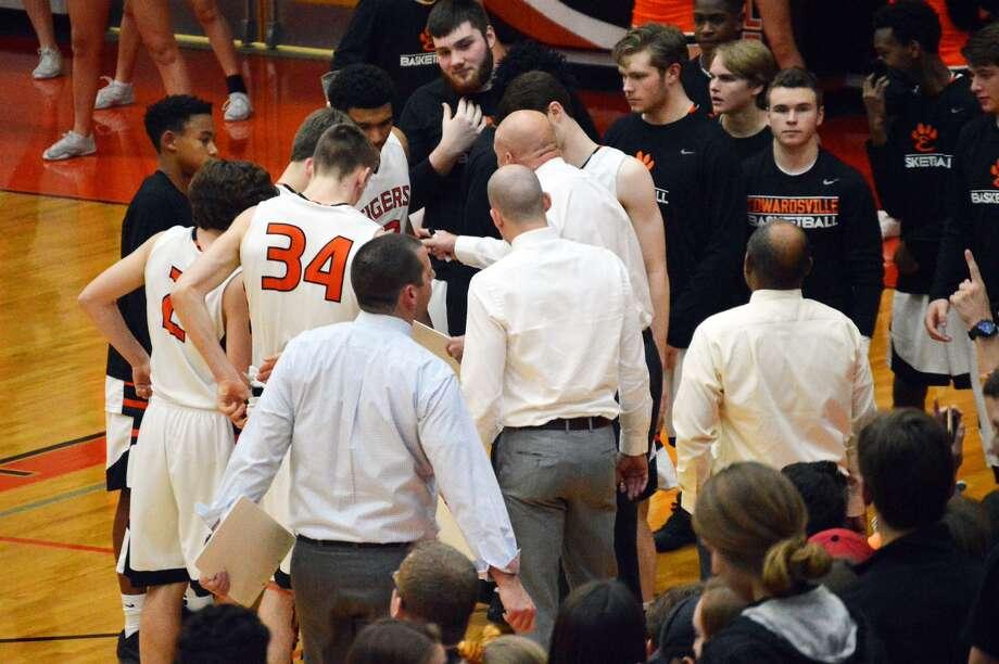 The Edwardsville boys' basketball team huddles together before the start of Friday's game against O'Fallon at Lucco-Jackson Gymnasium.