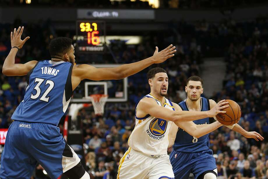 Golden State Warriors guard Klay Thompson (11) controls the ball through the defense of Minnesota Timberwolves center Karl-Anthony Towns (32) and guard Zach LaVine (8) in the second half of an NBA basketball game Sunday, Dec. 11, 2016, in Minneapolis. Golden State won 116-108. (AP Photo/Stacy Bengs) Photo: Stacy Bengs, Associated Press
