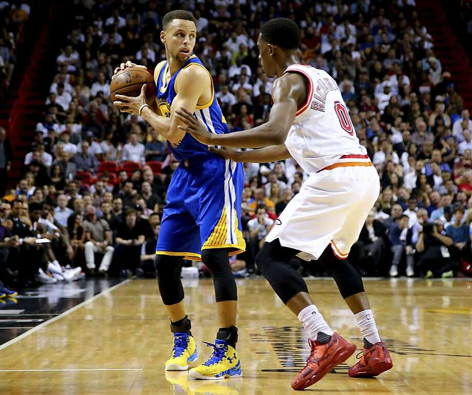 MIAMI, FL - FEBRUARY 24: Stephen Curry #30 of the Golden State Warriors is defended by Josh Richardson #0 of the Miami Heat during the game at the American Airlines Arena on February 24, 2016 in Miami, Florida.  NOTE TO USER: User expressly acknowledges and agrees that, by downloading and or using this photograph, User is consenting to the terms and conditions of the Getty Images License Agreement. (Photo by Rob Foldy/Getty Images) Photo: Rob Foldy, Getty Images