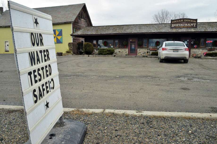 Sign in front of the Falls Diner restaurant Tuesday Jan. 26, 2016 in Hoosick Falls, NY.  A Health Department report said levels of PFOA that are considered safe for human consumption were found in several private wells, including at the Falls Diner restaurant on Route 22.  (John Carl D'Annibale / Times Union) Photo: John Carl D'Annibale