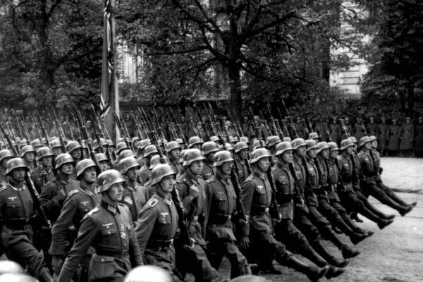 German soldiers parading in Warsaw after the invasion of Poland during World War II, September 28 - 30th, 1939. From a series of stereographic views, 'Soldaten des Fuhrers im Felde' ('The Fuhrer's Soldiers in the Field').