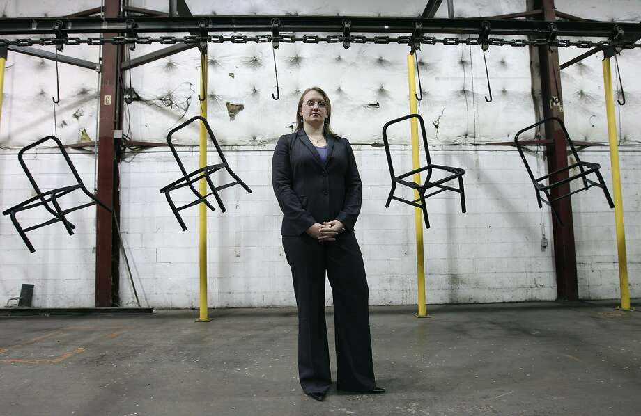 In this 2012 photograph, KLN Steel Products President Kelly O'Donnell stands near a conveyer carrying frames for metal chairs. An affiliated company, KLN Manufacturing, has shuttered its San Antonio operations. The plant's assets will be auctioned online later this month. Photo: Kin Man Hui /San Antonio Express-News / © 2012 San Antonio Express-News