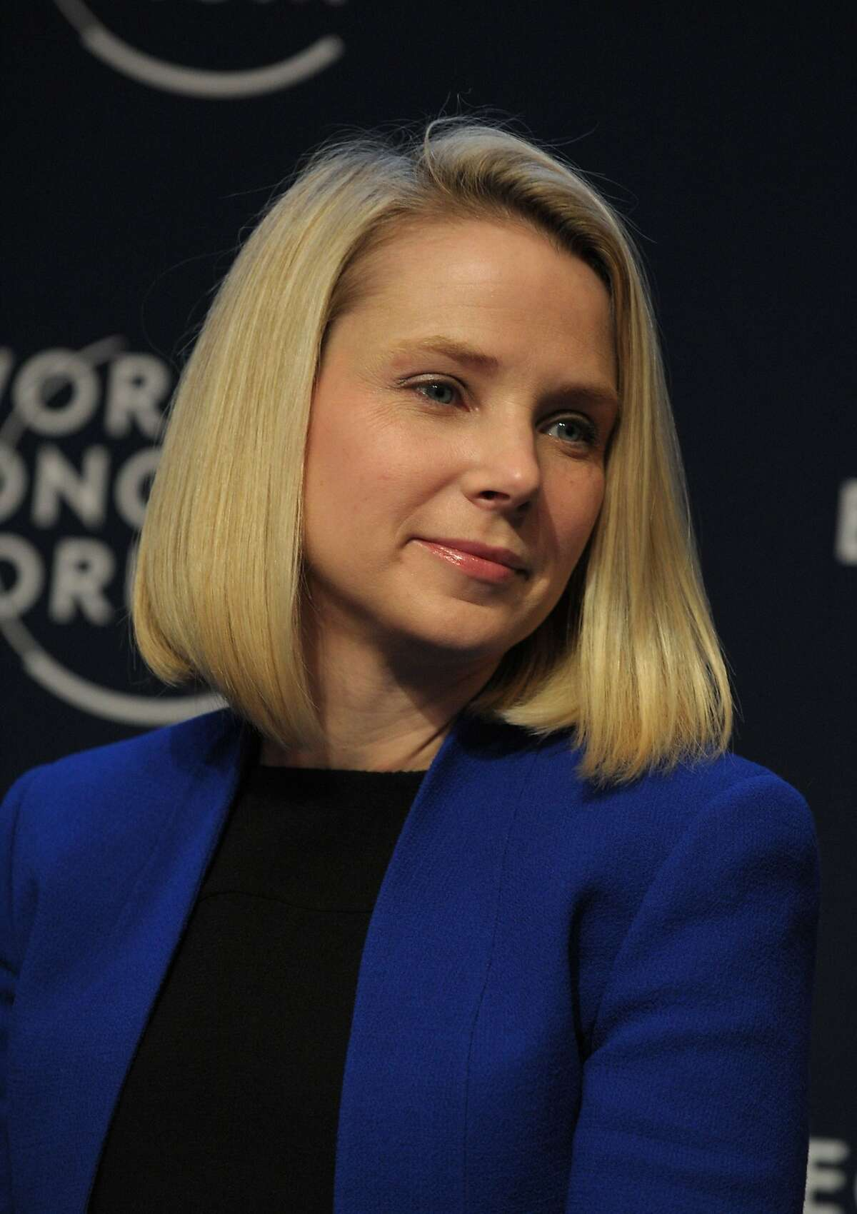 """(FILES) This file photo taken on January 22, 2014 shows Yahoo CEO Marissa Mayer taking part in the session """"the new digital context"""" on the opening day of the World Economic Forum in Davos, Switzerland. Yahoo confirmed on January 9, 2017 that chief executive Marissa Mayer will quit the company's board after its merger with Verizon. Mayer is expected to remain with Yahoo's core business, which is being bought by the US telecom titan. Yahoo is selling its main operating business as a way to separate that from its more valuable stake in Chinese internet giant Alibaba. / AFP PHOTO / ERIC PIERMONTERIC PIERMONT/AFP/Getty Images"""