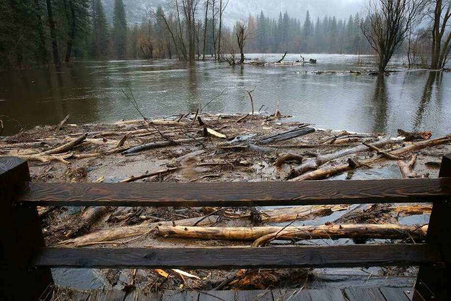 Swinging Bridge was at flood stage overnight as piles of debris collected at its base below on Monday Jan. 9, 2017, the day after heavy rains fell across Yosemite National Park, Ca.