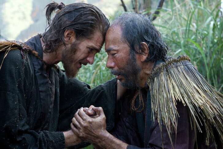 "Father Rodrigues (Andrew Garfield) consoles a Japanese Christian (Shinya Tsukamoto) in a scene from ""Silence."""