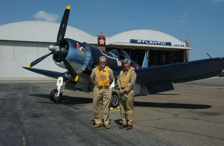 "Tom Duffy, owner of ""Marine's Dream,"" and Peter Guyton, both dressed in World War II flight gear. Duffy will display the plane at Wings and Wheels, Corsairs Over Connecticut at Sikorsky Memorial Airport Memorial Day weekend. Photo: Contributed Photo / Stamford Advocate Contributed"