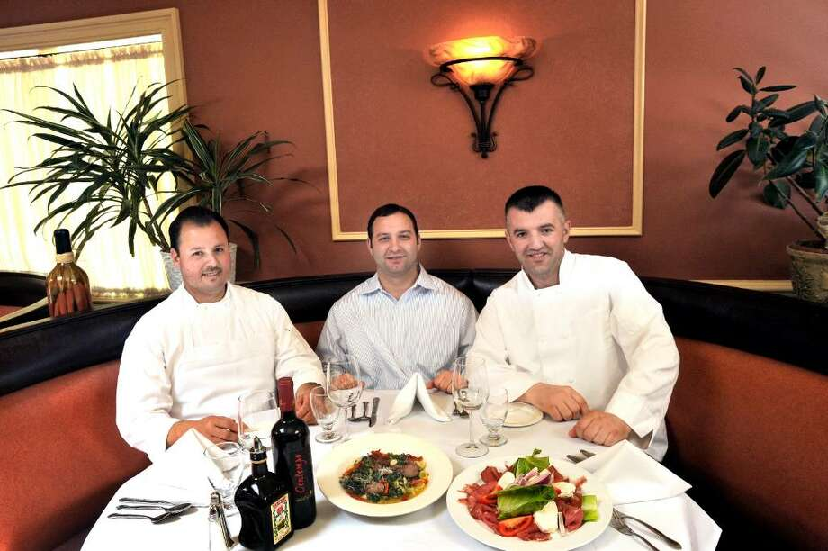 Partners Jimmy Monsalve, left, Roberto Giansanti and Ujkan Gjonbalaj, right, in Roberto's in Monroe on Thursday, May 13, 2010. Photo: Michael Duffy / The News-Times