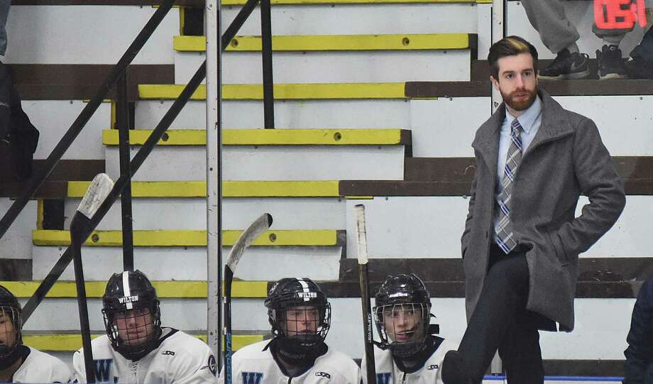 Wilton boys hockey coach John Miserendino watches the action as his team plays a game earlier this season. Photo: John Nash / Hearst Connecticut Media / Norwalk Hour