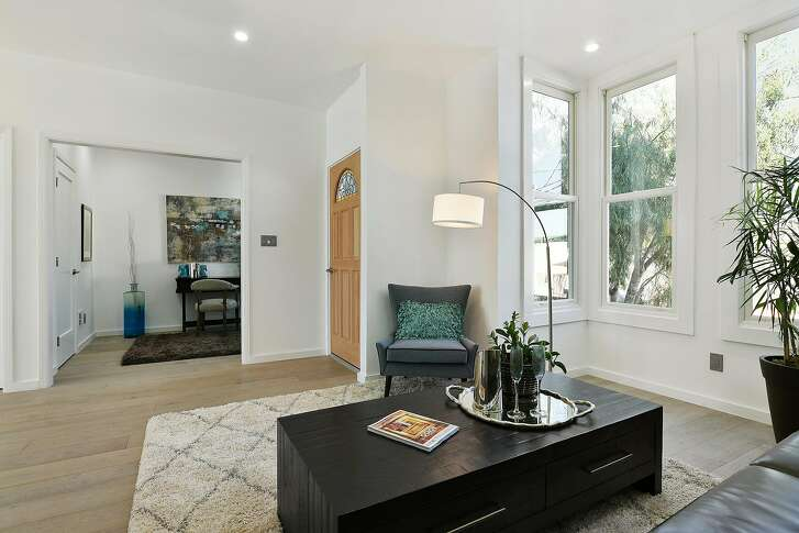 The open floor plan deposits guests into the great room immediately upon entering.