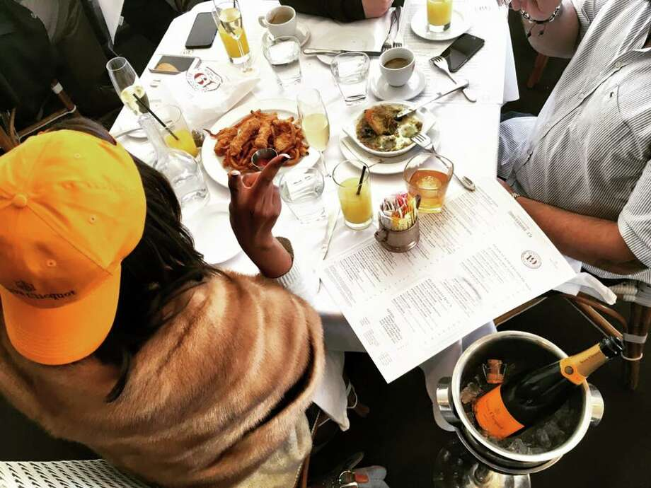 Here I am feasting on french fries and chicken tenders during an eight-hour brunch with friends at Brasserie 19. Anyone who frequents the French haunt knows that the true regulars dress casually. Obviously my Veuve Clicquot baseball cap juxtaposes (and justifies wearing) daytime mink. Photo: Amber Elliott