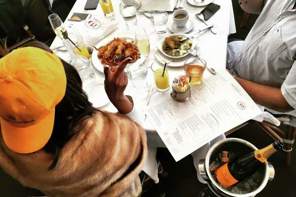 Here I am feasting on french fries and chicken tenders during an eight-hour brunch with friends at Brasserie 19. Anyone who frequents the French haunt knows that the true regulars dress casually. Obviously my Veuve Clicquot baseball cap juxtaposes (and justifies wearing) daytime mink.