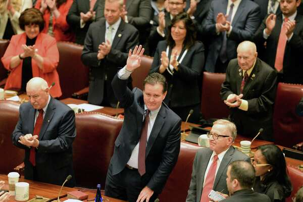 Senate Majority Leader John Flanagan, center, waves to supporters as he is reelected Majority Leader as the 2017 session of the NYS Legislature begins Wednesday Jan. 4, 2017, in Albany, N.Y.   (John Carl D'Annibale / Times Union)