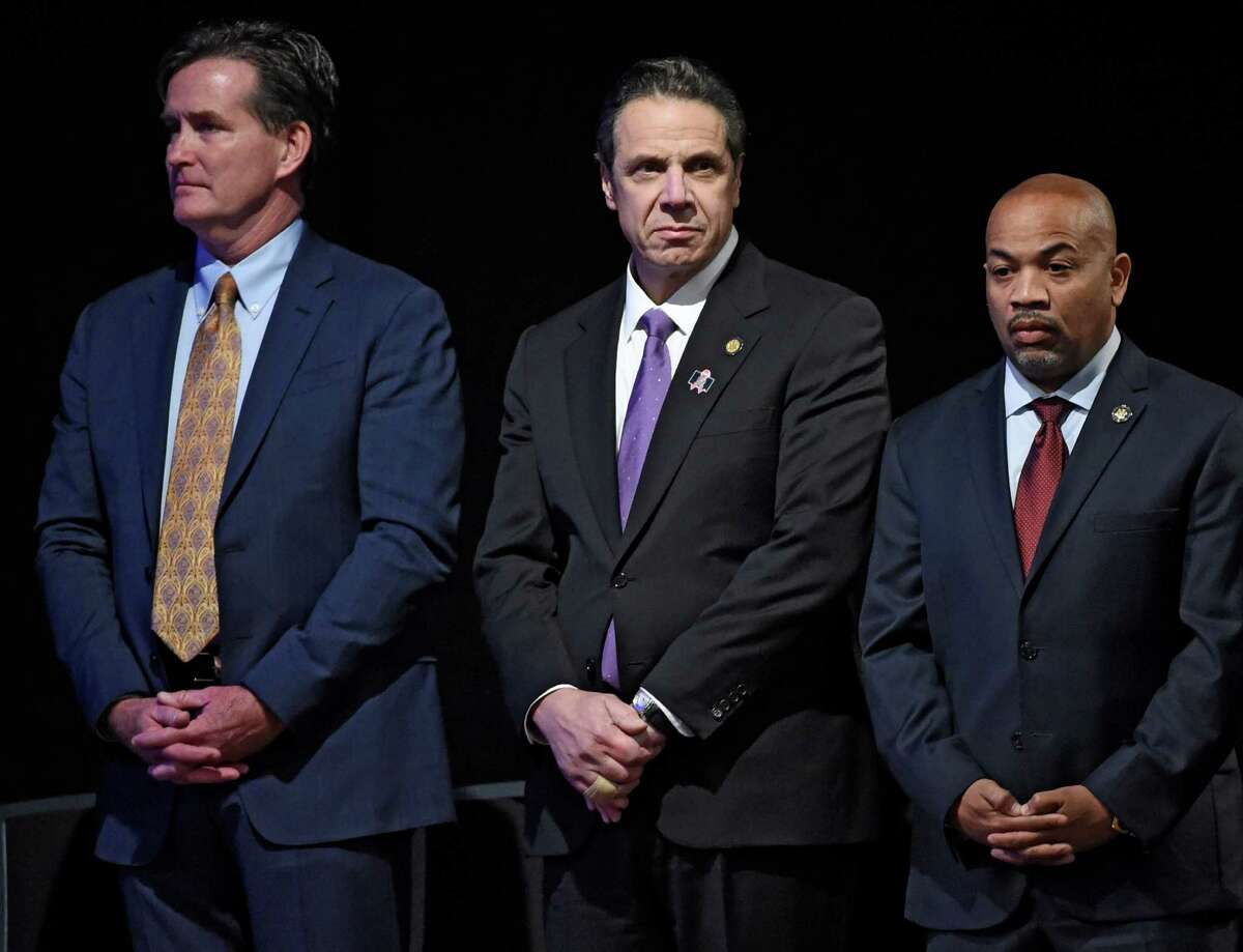 Gov. Andrew Cuomo, center, stands with Senate Majority Leader John Flanagan, left, and Speaker of the Assembly Carl Heastie before his presentation of the State of the State message at the Convention Center at the Empire Plaza on Wednesday, Jan. 13, 2016, in Albany, N.Y. (Skip Dickstein/Times Union)