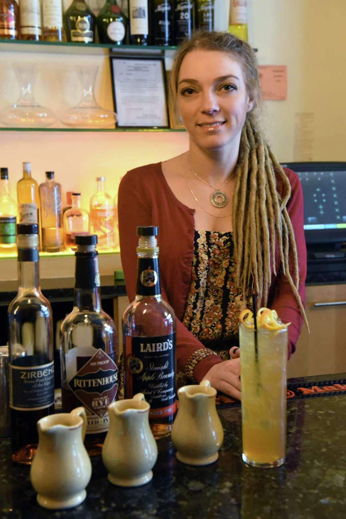 Alli Ferraro bartender at Hamlet & Ghost with her cocktail based on a former U.S. President Gerald Ford recipe on Thursday Dec. 22, 2016 in Saratoga Springs, N.Y. (Michael P. Farrell/Times Union)