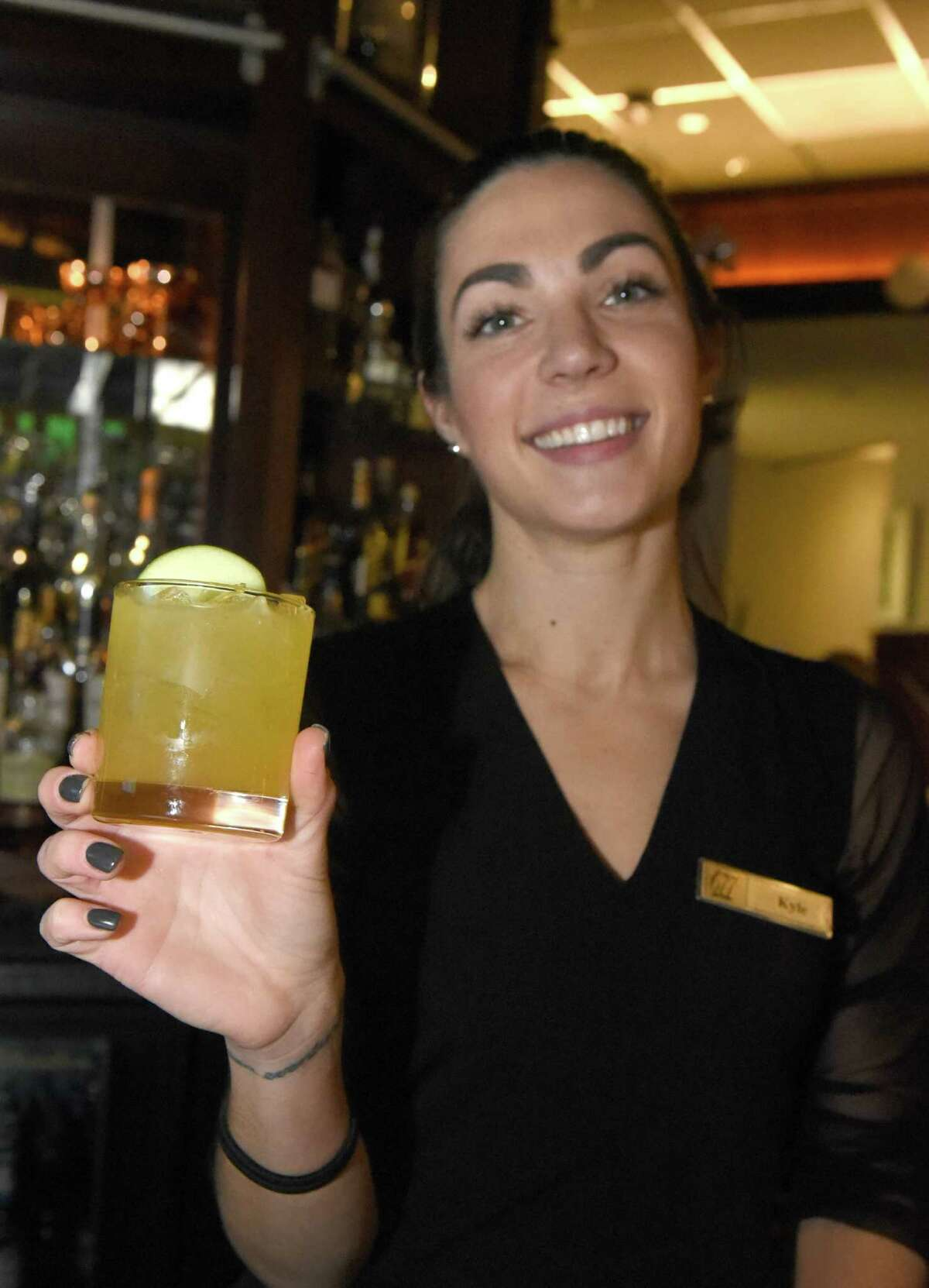 Bartender Kyle Cerutti with her President Martin Van Buren inspired cocktail at 677 Prime on Friday Dec. 23, 2016 in Albany N.Y. (Michael P. Farrell/Times Union)