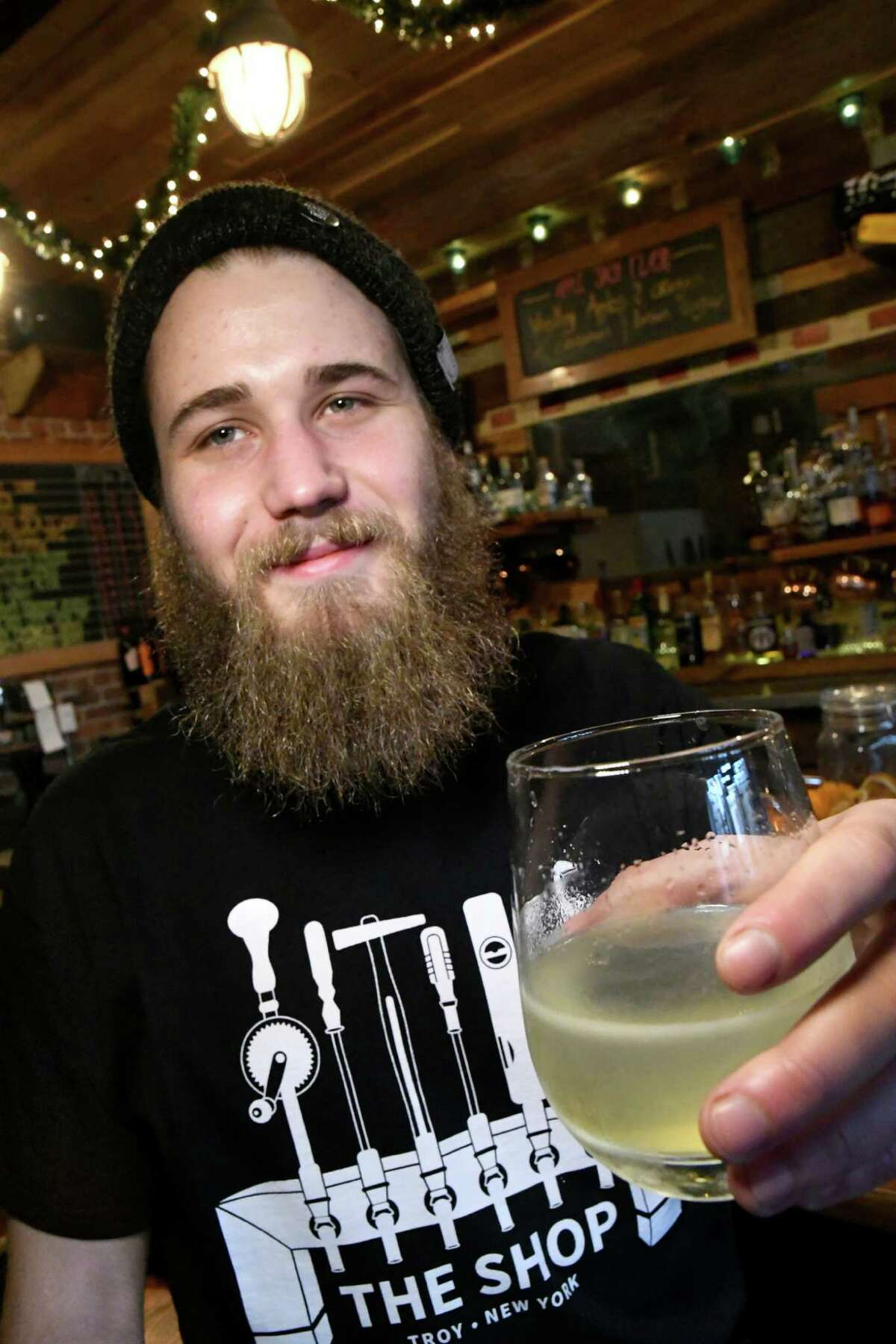 Bartender Sam Hooker holds The Trickle Down cocktail on Friday, Dec. 23, 2016, at The Shop in Troy, N.Y. (Cindy Schultz / Times Union)