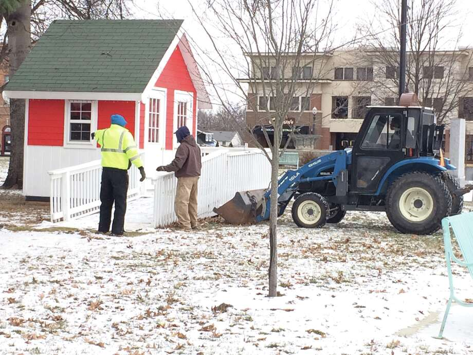 City crews were out Monday morning to begin the process of removing Santa Claus' house from City Park. Santa will, no doubt, return for 2017. Photo: John Sommerhof • Intelligencer