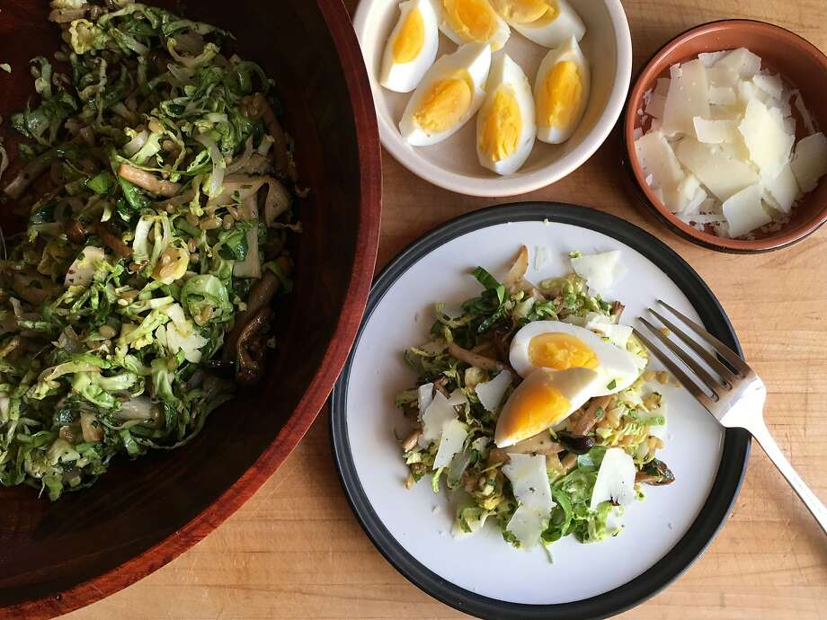 Raw, shaved Brussels sprouts serve as the base for this hearty salad with roasted mushrooms, wheat berries and hard boiled eggs. Photo: Sarah Fritsche, Sarah Fritsche/The Chronicle