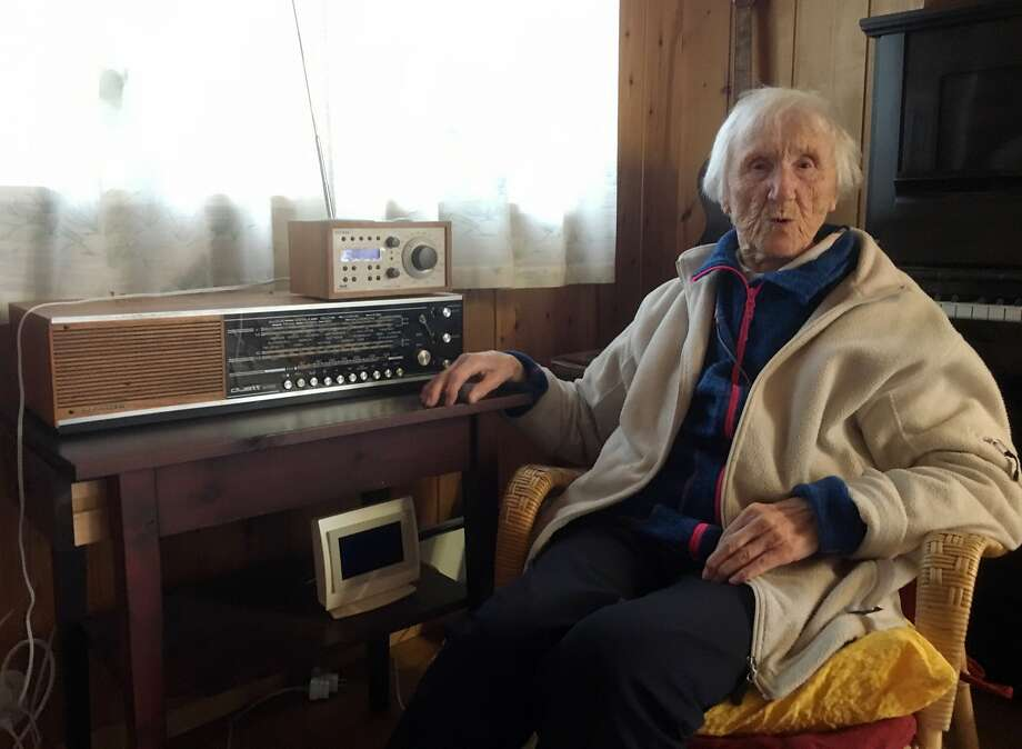 In this photo taken on Sunday, Jan. 8, 2017, 98-year-old Judith Haaland sits next to her decades-old radio set in Stavanger, Norway. In a move likely to be watched closely by other nations, the Norwegian government will begin shutting off the FM signal on Wednesday, Jan. 11, 2017. By the end of the year, national networks will be available only on Digital Audio Broadcast, or DAB. (AP Photos/Mark Lewis) Photo: Mark Lewis, Associated Press