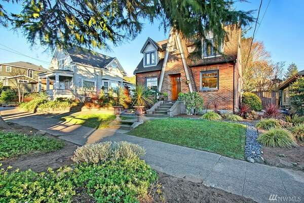 First up, a storybook cottage with all of the amenities of Loyal Heights. Charming details include built-ins in the bedrooms, fireplace with Batchelder tile surround, and a carnival glass slipper-style light fixture. The kitchen window looks out to the large private backyard, with stone patio, flower beds, and large grassy space. This home, listed on the Ballard Historical Society's website, is just blocks away from Salmon Bay Park & Grumpy's Coffee. It is ready to make new fairy tales and memories. 