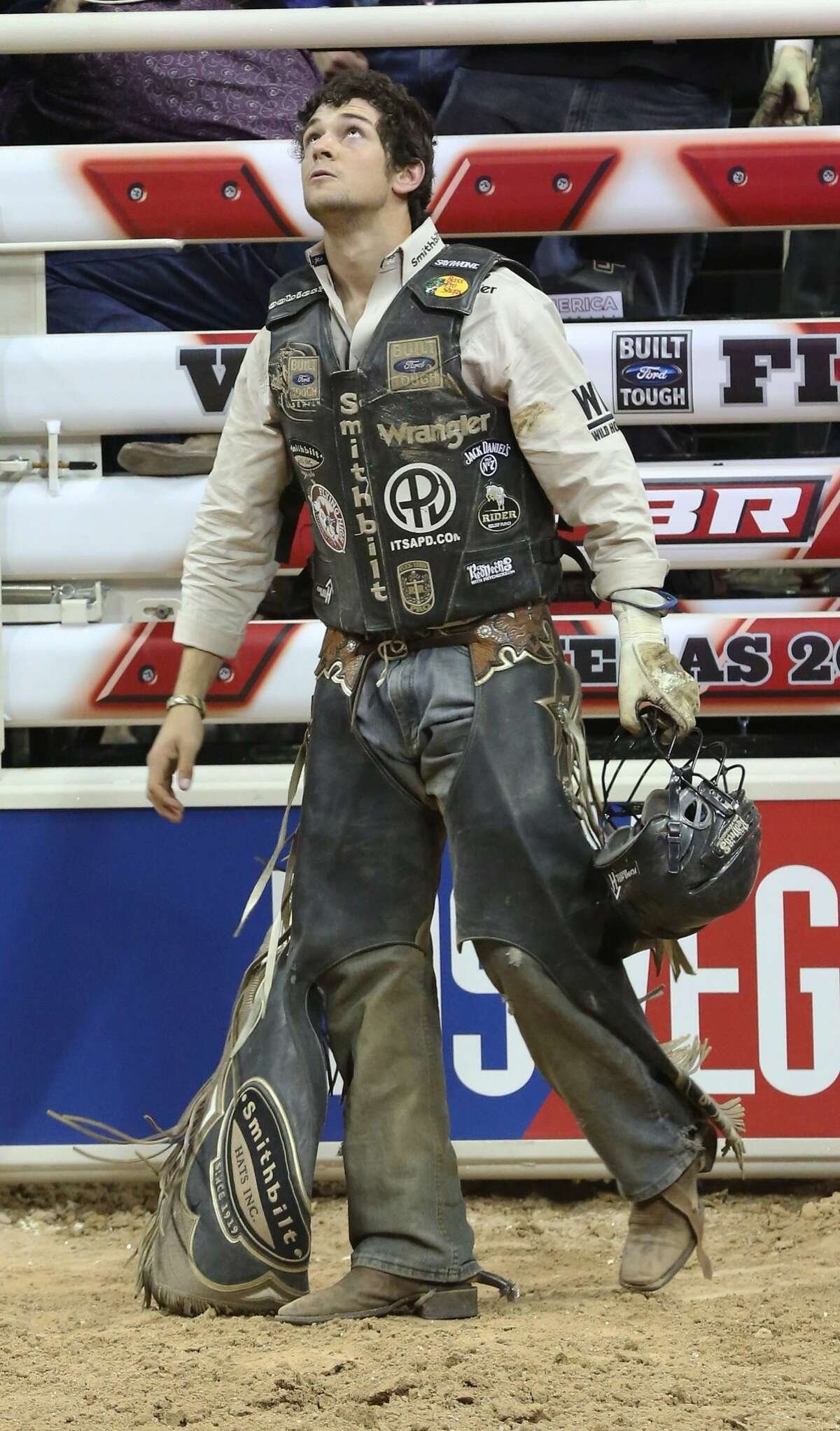 LAS VEGAS, NV - OCTOBER 23: Professional bull rider Ty Pozzobon checks his score at the Professional Bull Riders Built Ford Tough World Finals at the Thomas & Mack Center on October 23, 2013 in Las Vegas, Nevada. (Photo by Gabe Ginsberg/FilmMagic)