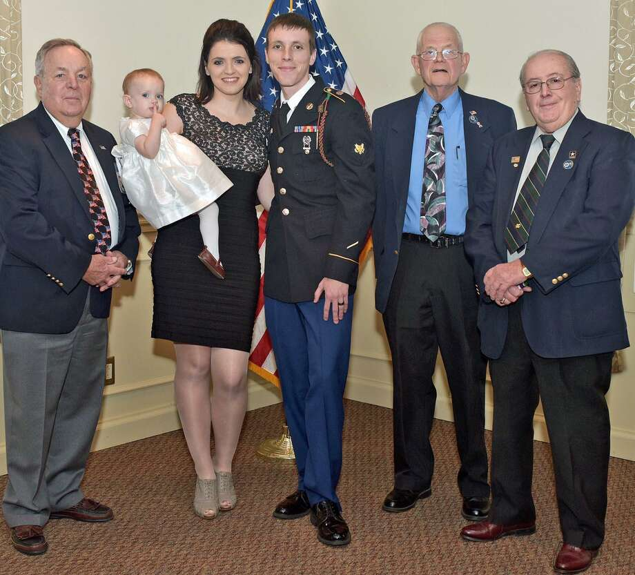From left, Danbury Exchange Club director Al Mead, Rebekah Sexton with baby Olivia, Alan Sexton, club treasurer David Treadwell, and club secretary Robert LeFebvre. Photo: / Western Connecticut State University / WCSU