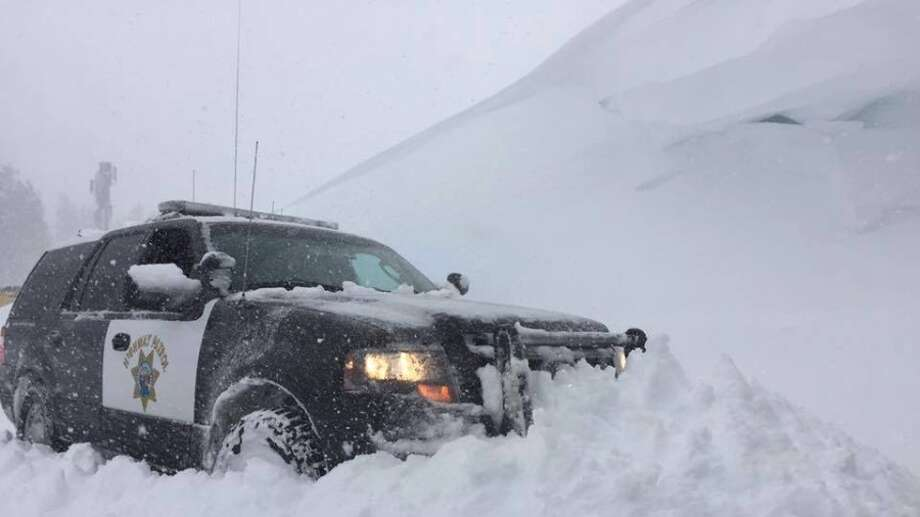 The CHP Truckee office shared this photo of a patrol vehicle parked next to a snow hill along I-80.